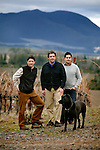 Peter Molnar, center, and his brother Peter, left, both partners of Tricycle Wine Company and Obsidian Ridge Vineyards, and winemaker Alex Beloz, and the family dog, Wendell, in the Obsidian Ridge Vineyard, in the Red Hill appellation of Kelseyville, Ca., on Tuesday, Feb. 2, 2010. A view of Mt. Konocti looms in the background.