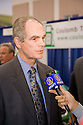Chuck Reed, Mayor of San Jose, is interviewed after announcing new smart charging stations infrastructure for plug-in vehicles through a partnership with Coulomb Technologies. Coulomb's ChargePoint charging stations will be attached to streetlight poles and other access points. Secure charging access can be purchased by plug-in vehicle drivers. Opening day of the July 22-24 inaugural Plug-In 2008 Conference & Exposition: A Short Drive to Tomorrow in San Jose, CA. The event showcases the latest technological advances, market research and policy initiatives shaping the future of plug-in hybrid electric vehicles (PHEVs). Original photo is high-resolution (4368 x 2912 pixels).