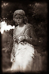 A female statue in cemetery
