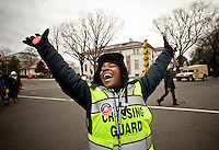 Mariama, a jubilant volunteer street crossing guard welcomes people to Washington DC ahead of the inauguration of Barack Obama as the 44th President of the United States.