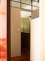 This tiled bathroom is screened from the rest of the apartment by a solid partition
