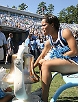 02 September 2006: A UNC cheerleader rings the bell. The University of North Carolina Tarheels lost 21-16 to the Rutgers Scarlett Knights at Kenan Stadium in Chapel Hill, North Carolina in an NCAA Division I College Football game.