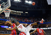 Ohio State Buckeyes forward Sam Thompson (12) lands on Dayton Flyers guard Khari Price (0) after leaping for a rebound in the second half of the second-round NCAA Tournament game between the Ohio State Buckeyes and the Dayton Flyers at the First Niagara Center, Thursday afternoon, March 20, 2014. The Dayton Flyers defeated the Ohio State Buckeyes 60 - 59. (The Columbus Dispatch / Eamon Queeney)