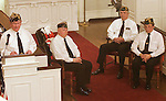 WATERBURY, CT-03 FEBRUARY 2004 -020305JS03-George Wityak of the Emil Senger American Legion Post 10 in Seymour, left, representing Chaplain Clark Poling, gives narration during the Saga of the Four Chaplains memorial service held Thursday at the Seymour Congregational Church, UCC, as other members of the post, from left, William Youschak representing Chaplain John Washington, George Bashura, Jr. representing Chaplain Alexander Goode and Don Reidy, Sr.  representing Chaplain George Fox look on. The service was held to remember the four Army Chaplains who were serving aboard the USAT Dorchester when it was hit by an enemy torpsdo and sank in the North Atlantic on February 3, 1943.                                                                                                   --  Jim Shannon Photo--George Wityak, Chaplain Clark Poling, Saga of the Four Chaplains, Seymour Congregational Church, UCC,  William Youschak, Chaplain John Washington, George Bashura, Jr.,Chaplain Alexander Goode, Don Reidy, Sr., Chaplain George Fox, USAT Dorchester .                           are CQ