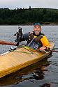 WA09176-00...WASHINGTON - Phil Russell with a black rock fish caught kayak fishing in the Straits of Juan de Fuca. (MR# R8)