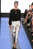 Debora walks runway in a carbon black georgette long slash sleeve blouse, and carbon black stretch wool pant with splatter print front, by Monique Lhuillier, from the Monique Lhuillier Spring 2012 collection fashion show, during Mercedes-Benz Fashion Week Spring 2012.