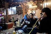 Women smoking a shisha (sheesha, Narghile, Hookah) an act that has been banned for women in public.