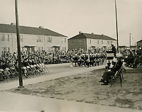 1941  October  17..Merrimack Landing   ..Scene at Dedication Cermony at Merrimack Park, 10-17-1941.  Band and Color Guard from USS Wyoming in foreground.  Capt. Pawnell, Commanding Officer of the Naval Air Station, Norfolk, VA speaking.  Ceremony took place immediately in front of the Community Building....NEG#.446..