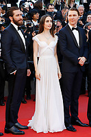 """(L-R: Jake Gyllenhaal, Lily Collins and Paul Dano at the """"Okja"""" premiere during the 70th Cannes Film Festival at the Palais des Festivals on May 19, 2017 in Cannes, France. (c) John Rasimus /MediaPunch ***FRANCE, SWEDEN, NORWAY, DENARK, FINLAND, USA, CZECH REPUBLIC, SOUTH AMERICA ONLY***"""