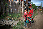 Two young sisters laughing in the village of Sandrandahy, in the central highlands of Madagascar.