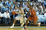 18 December 2013: North Carolina's Marcus Paige (5) and Texas' Demarcus Holland (2). The University of North Carolina Tar Heels played the University of Texas Longhorns at the Dean E. Smith Center in Chapel Hill, North Carolina in a 2013-14 NCAA Division I Men's Basketball game. Texas won the game 86-83.