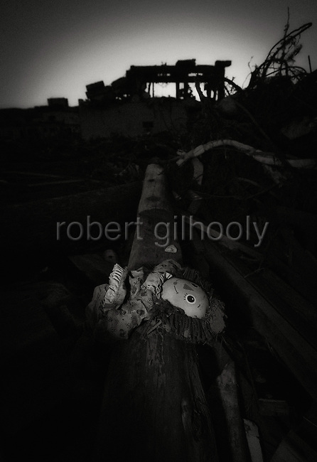 A doll lies among the debris in Rikuzentakata, Iwate Prefecture, Japan.  Photographer: Robert Gilhooly