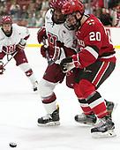 Luke Esposito (Harvard - 9), Joe Sullivan (SLU - 20) - The Harvard University Crimson defeated the St. Lawrence University Saints 6-3 (EN) to clinch the ECAC playoffs first seed and a share in the regular season championship on senior night, Saturday, February 25, 2017, at Bright-Landry Hockey Center in Boston, Massachusetts.