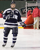 Kevin Goumas (UNH - 27) - The University of Maine Black Bears defeated the University of New Hampshire Wildcats 5-4 in overtime on Saturday, January 7, 2012, at Fenway Park in Boston, Massachusetts.