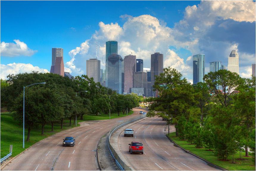From a pedestrian bridge that spans both Buffalo Bayou and Memorial Parkway, this photo shows the view looking towards downtown Houston and the skyline of the largest city in Texas. This cityscape of H-Town was taken on a nice, muggy, September afternoon.