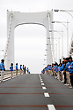 Staff line up on Tokyo's Rainbow Bridge for a public event, gRainbow Walkh, designed to promote the cityfs bid to host the 2016 Olympic Games. Roughly 5,000 people, wearing scarves and gloves in the five Olympic colors, took a 7-kilometer walk amid occasional light rain on the 50-meter-high expressway bridge to Odaiba Park Tokyo Bay. 1 March, 2009. (Taro Fujimoto/JapanToday/Nippon News)
