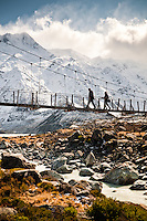 Tourists on a swingbridge over the Hooker River - Mt. Cook National Park, Mackenzie Country, New Zealand
