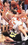 Sentinel/Dan Irving.Hope College sophomore Stacy Warsen (24) gets knocked over while scrambling for a loose ball during the MIAA Championship game against Calvin College Saturday afternoon at the DeVos Fieldhouse..(2/25/06)