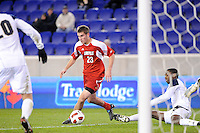 J.T. Murray (23) of the Louisville Cardinals moments before scoring. The Louisville Cardinals defeated the Notre Dame Fighting Irish 1-0 during the semi-finals of the Big East Men's Soccer Championship at Red Bull Arena in Harrison, NJ, on November 12, 2010.