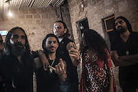 August 27, 2014 - Binyamina, Haifa District, Israel: From left to right: Uri (bass player), Cem (guitar player), Kobi Farhi (singer), Shlomit Levi (singer) and Idan (guitar player) musicians at Orphaned Land heavy metal band pose for picture in the backstage before to perform a concert in Binyamina Amphitheatre at north of Israel. Orphaned Land is a music band founded by Jewish and Arabian musicians who combine ethnic music with rock metal as they recite verses in Hebrew and Arabic from the sacred Quram and Tora Scriptures. (Narciso Contreras/Polaris)