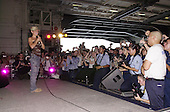 Actress Alyssa Milano speaks to sailors at the United Service Organization (USO) show during a visit aboard USS Nimitz (CVN 68) on June 19, 2003.  Nimitz Carrier Strike Force and Carrier Air Wing Eleven (CVW-11) are deployed in support of Operation Iraqi Freedom.  Operation Iraqi Freedom is the multi-national coalition effort to liberate the Iraqi people, eliminate Iraq's weapons of mass destruction, and end the regime of Saddam Hussein.   .Credit: U.S. Navy via CNP.