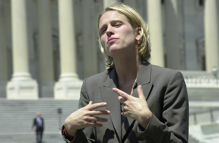 """Miller E.4(DG) 072000 -- Elizabeth Miller, director of special events for the office of the Democratic Leader, does a demo tape for the producers of the T.V. show """"Servivors"""" in front of the U.S. Capitol."""