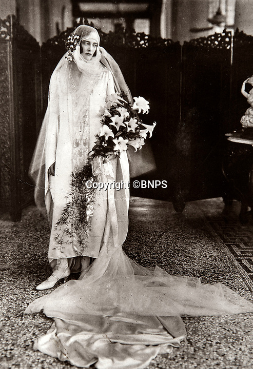 BNPS.co.uk (01202 558833)<br /> Pic: PhilYeomans/BNPS<br /> <br /> High Fashion - Cicely Winifred Goschen, daughter of the Governor, married Major Edward Bertram Portal in a spectacular wedding in November 1926.<br /> <br /> Last Days of the Raj - A fascinating family album from one of the last Viceroy's of India reveal Britain's 'Jewel in the Crown' in all its splendour.<br /> <br /> The family album of Viscount George Goschen has been unearthed after 90 years, and provide's an amazing snapshot of the pomp and pageantry of a wealthy and powerful British family in India in the 1920s and 30's.<br /> <br /> They show the Governor of Madras and his family enjoying a lavish lifestyle of parades, banquets and hunting and horse racing in the last decades of the Raj.<br /> <br /> At the time, Gandhi was organising peasants, farmers and labourers to protest against excessive land-tax and discrimination. <br /> <br /> The album consists of some 300 large photographs. They have remained in the family for 90 years but have now emerged for auction following a house clearance and are tipped to sell for &pound;200.