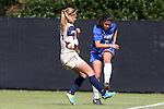 27 October 2013: Duke's Mollie Pathman (right) sends the ball up the field past Pittsburgh's Ella Vanhanen (FIN) (left). The Duke University Blue Devils hosted the Pittsburgh University Panthers at Koskinen Stadium in Durham, NC in a 2013 NCAA Division I Women's Soccer match. Duke won the game 6-3.