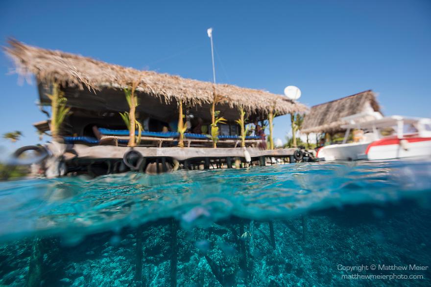 Fakarava Atoll, Tuamotu Archipelago, French Polynesia; an over under view of the restaurant and pier at the Tetamanu Village