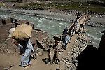 Residents of Kalam negotiate a makeshift bridge across the Swat river - cut off from the rest of the country, Kalam and towns further north are completely depended on daily helicopter relief drops and men carrying supplies to remoter locations.