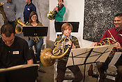 Abbot Timmons, 11, tries out a French Horn with members of NC Opera brass before a preview concert of Wagner selections at Flander's Gallery, Monday, Jan. 21, 2013. Timmons is studying under Opera brass player Andrew McAfee, right. .