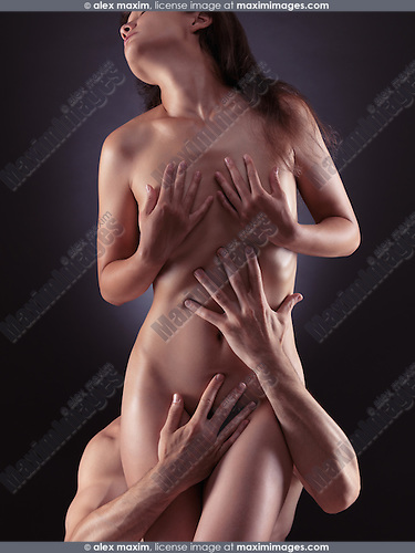 Artistic sensual photo of a beautiful naked woman and a man