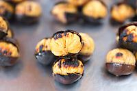 Roasted chestnuts on sale in The Grand Bazaar, Kapalicarsi, great market in Beyazi, Istanbul, Turkey