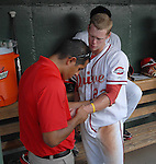 Trainer David Herrera of the Greenville Drive tends to Jeremy Hazelbaker's injured wrist  in a game on June 14, 2010, at Fluor Field at the West End in Greenville, S.C. Photo by: Tom Priddy/Four Seam Images