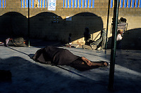 Indigents find a space to sleep and rest at a sufi shrine in the city of Karachi - such shrines offer refuge and food to the poor and needy and to the millions who come from villages across the country to seek the saints' blessing.