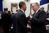 United States President Barack Obama talks with Governor Jay Nixon (Democrat of Missouri) during a meeting with the Democratic Governors Association in the Eisenhower Executive Office Building of the White House, February 24, 2012. .Mandatory Credit: Pete Souza - White House via CNP