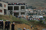 Druze Sheikhs arrive to calm things down with Israeli riot policemen, after Druze youth hurled stones at Israeli soldiers in Majdal Shams, Golan Heights, as protesters marked the 44th anniversary of the 1967 Six-Day War at Syria-Israel border. Israeli troops opened fire at Palestinian protesters in Syria, who rushed towards the border fence; Syrian state reports said 23 demonstrators were killed.<br />