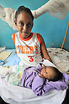 In a clinic of the United Methodist Church in Kananga, a town in the Democratic Republic of the Congo, Therese Ntumba cares for her newborn girl, Josephine, just hours after giving birth.