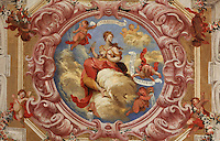 Allegorical trompe l'oeil fresco painted by Antonio Simoes Ribeiro and Vicente Nunez, central medallion of the ceiling of the Red Room of the Joanina Library, or Biblioteca Joanina, a Baroque library built 1717-28 by Gaspar Ferreira, part of the University of Coimbra General Library, in Coimbra, Portugal. The Casa da Livraria was built during the reign of King John V or Joao V, and consists of the Green Room, Red Room and Black Room, with 250,000 books dating from the 16th - 18th centuries. The library is part of the Faculty of Law and the University is housed in the buildings of the Royal Palace of Coimbra. The building is classified as a national monument and UNESCO World Heritage Site. Picture by Manuel Cohen