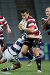Sherwin Stowers gets tackled by Gareth Anscombe during the ITM Cup Round 7 rugby game between Auckland and Counties Manukau, played at Eden Park, Auckland on Thursday August 11th..Auckland won 25 - 22.