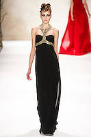 Simona Andrejic walks runway in a Monique Lhuillier Fall 2011 outfit, during Mercedes-Benz Fashion Week Fall 2011.