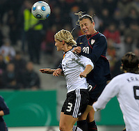 Abby Wambach (20) goes up for the header against Saskia Bartusiak (3). US Women's National Team defeated Germany 1-0 at Impuls Arena in Augsburg, Germany on October 27, 2009.