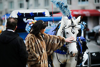 A woman touches a horse-drawn cab in Central Park, New York, 01/20/2016 NYC Mayor Bill de Blasio plans to reduce the number of carriages and restrict them to ride in Central Park. Photo by VIEWpress