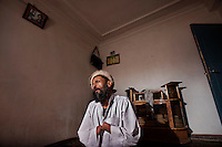 "June 22, 2011...A portrait of Mohammad Qasem Takawar during prayer in Herat, Afghanistan...""I am Mohammad Qasem Takawar, a disabled Mujahadeen of the Islamic revolution. Twenty years ago I lost my two hands and eye in a mine explosion while I was 27 years old. A mine was planted in the middle of an alley in Pashtoon Zarghoon. The war finally reached a ceasefire. Our Islamic responsibility was to clear the mines. With the help of God, we cleared all the mines until 3:30 am. The last mine which exploded caught me. I am proud that the mine hit me. Because if the mine exploded on some of our citizens today, my conscience would feel very bad.""..*** NOTE TO EDITORS: All images conform to the standard industry practice of retouching, toning and color-correction for images. For a detailed description of the photoshop workflow used to tone each image, please refer to the ""Special Instructions"" section of the IPTC information. ***"