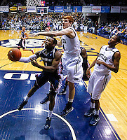 INDIANAPOLIS, IN - FEBRUARY 19: Derrick Colter #1 of the Duquesne Dukes shoots the ball as Erik Fromm #4 of the Butler Bulldogs defends over the top at Hinkle Fieldhouse on February 19, 2013 in Indianapolis, Indiana. Butler defeated Duquesne 68-49. (Photo by Michael Hickey/Getty Images) *** Local Caption *** Derrick Colter; Erik Fromm