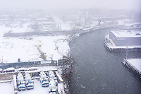 "Industry along the Gowanus canal in Brooklyn in New York is seen during a snow storm on Tuesday, January 21, 2014. The city is expected to receive between 8 and 14 inches of snow with brutal ""Polar Express"" temperatures in the single digits. The snow will taper off by Wednesday morning but the arctic temperatures are expected to last several days.  (© Richard B. Levine)"