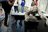 "A man looks at a statue outside the Memorial Hall of the Nanjing Massacre in Nanjing, China. After two years of renovations, the Memorial Hall of the Nanjing Massacre reopened on Dec. 13, 2007, the 70th anniversary of the 6-week massacre by Japanese troops that started Dec. 13, 1937 and claimed more than 300,000 lives.  The commemoration comes amid renewed controversy about the accuracy of historical accounts of the massacre.  The massacre is also known as ""The Rape of Nanking."""