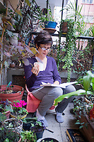 Annuska on the balcony with her diary and coffee. Progreso and Prosperidad, Mexico City