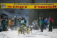 Musher Buddy Streeper at the start of the oldest continuously run sled dog race in the world, the 2003 Open North American Sled dog championships which start on the Chena river in downtown Fairbanks, Alaska. The annual race consists of three daily races, the combined fastest time wins.