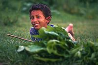 Young boy at play, Hadigau, Nepal.